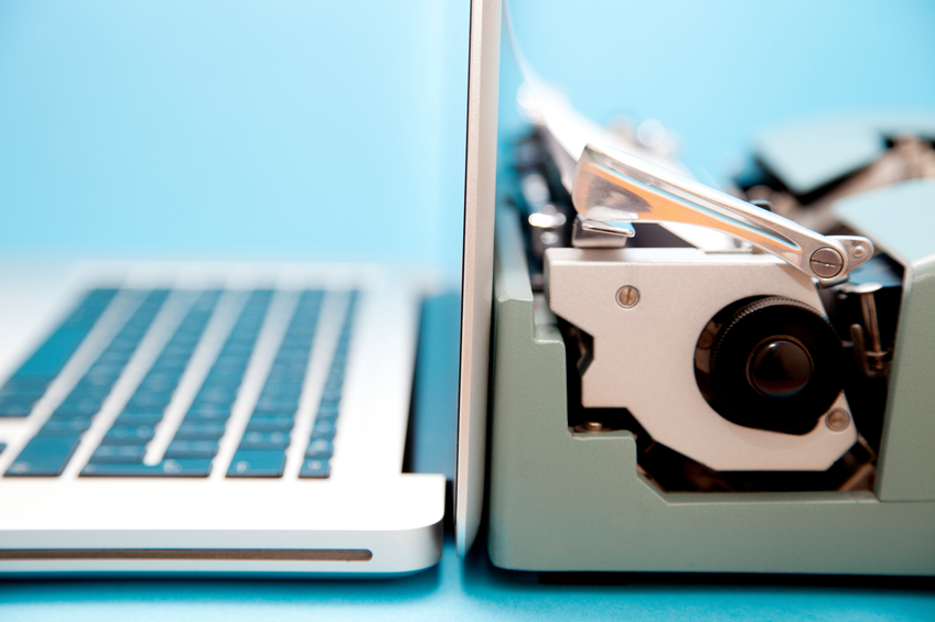 A typewriter and a laptop - innovation in tech