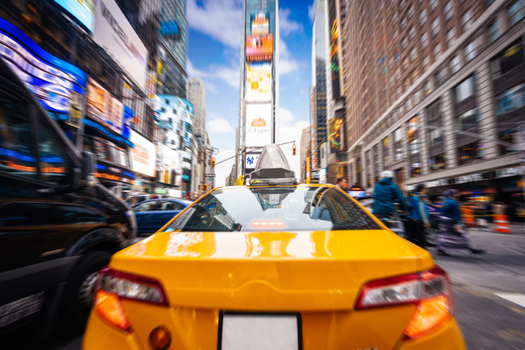 Taxi goes fast in Times Square, New York