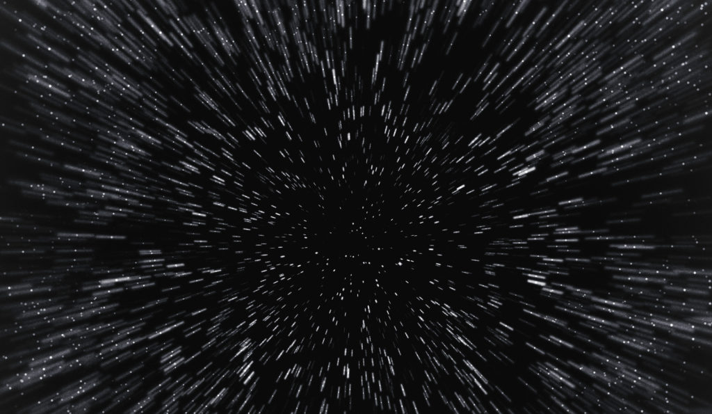 Time travel in space. Motion blurred stars background.