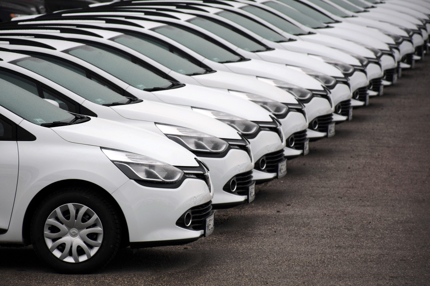 A row of new cars. Social media is changing the relationship of cars and millennials.