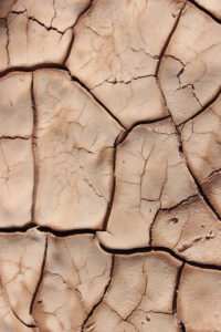 Dried out and cracked yellow earth
